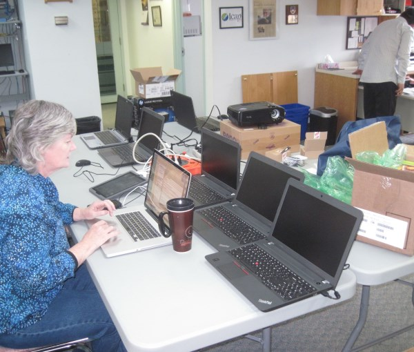 Configuring the computers at the Bible Society office before the workshop