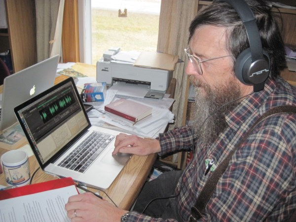 Bill listening to and editing the Gospel of Luke audio in Plains Cree