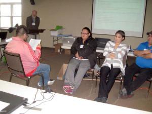 Naskapi translator Tshiueten Vachon, checking Exodus with consultant Steve Kempf, and team-members Amanda Swappie, Jessica Nattawappio, and George Guanish